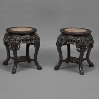 A Pair of Carved Chinese Hardwood Stands With Inset Marble Tops