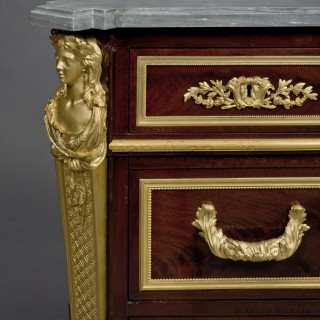 A Louis XVI Style Gilt-Bronze Mounted Mahogany Commode