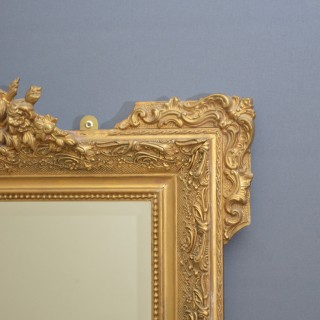 A Very Decorative Gilt Mirror