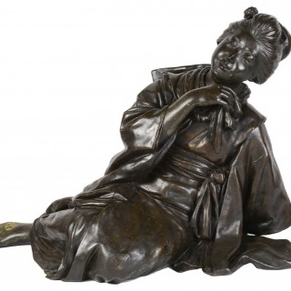 Rare large Meiji period Bronze of a reclining female.