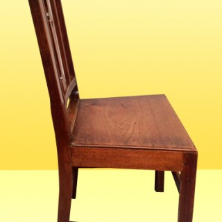 A set of six Georgian fruitwood country dining chairs.