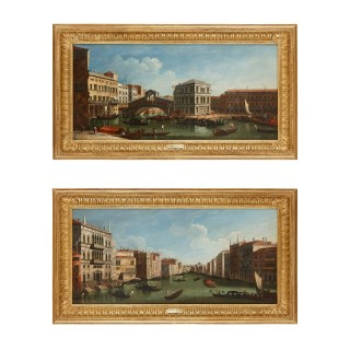 Two Venetian vedute oil paintings in giltwood frames after Canaletto