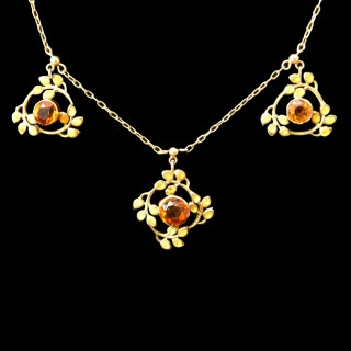A Jessie King gold and citrine Liberty necklace