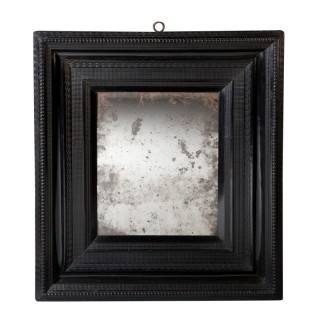 A Dutch ebony ripple frame pier mirror