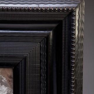 A Dutch ebony ripple frame pier mirror