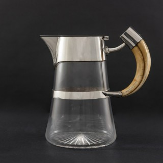 Cut Glass Claret Jug with Silver Mounts and Boars Tusk Handle