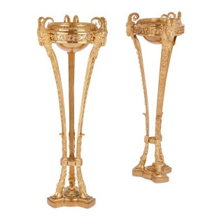 Two antique Neoclassical style gilt bronze tripod stands