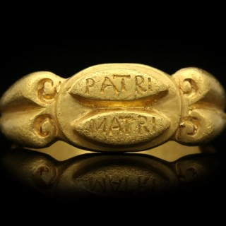 Ancient Roman 'mother father' gold ring, circa 3rd century AD.