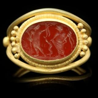 Ancient Roman Apollo and Salus intaglio ring, circa 3rd-4th century AD.