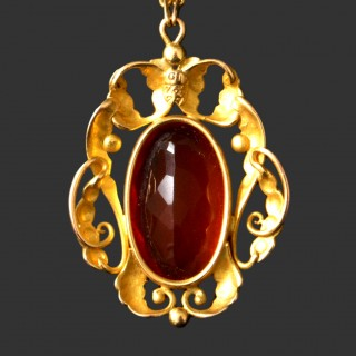 An exceptional Georg Jensen gold and fire opal pendant