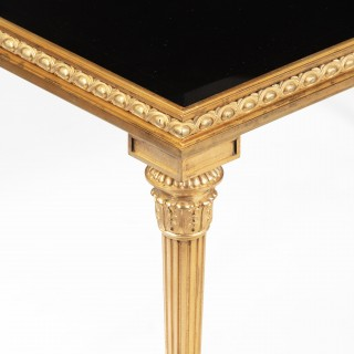 A fine pair of French ormolu low side tables