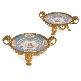 Two Sevres style gilt bronze mounted painted porcelain plates