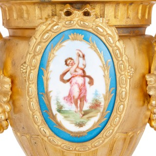 Two Sevres style porcelain mounted gilt bronze vases by Mourey