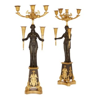 Pair of antique French patinated and gilt bronze candelabra