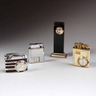 MID 20TH CENTURY – A COLLECTION OF FOUR WATCH MOUNTED LIGHTERS