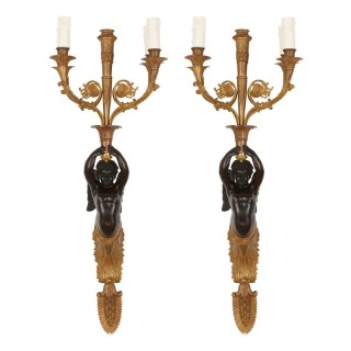 Two antique French gilt and patinated bronze sconces