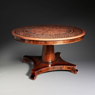 A Regency circular dining table