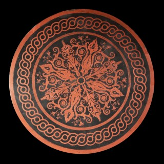 A Regency circular dining table