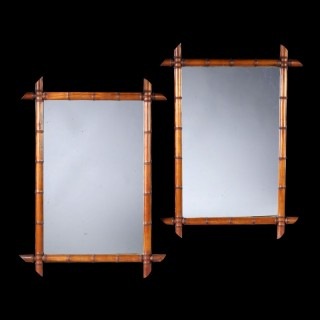 A pair of simulated bamboo pier mirrors