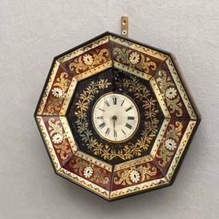 An eglomise wall clock