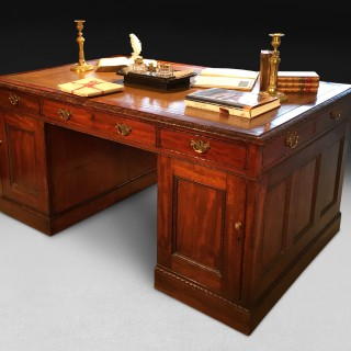 A  mid 19th Century Mahogany Partners Desk