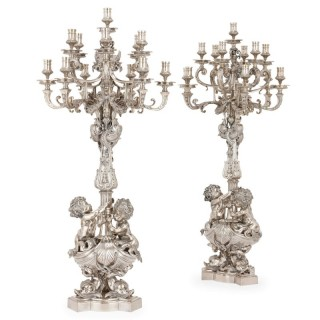 Two large Louis XIV style silvered bronze thirteen-light candelabra
