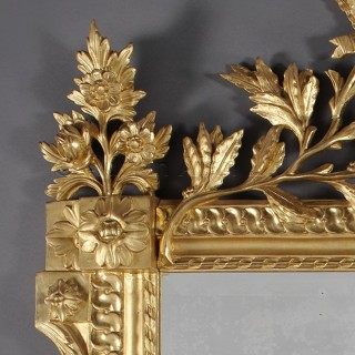 A Fine Louis XVI Style Carved Giltwood Mirror