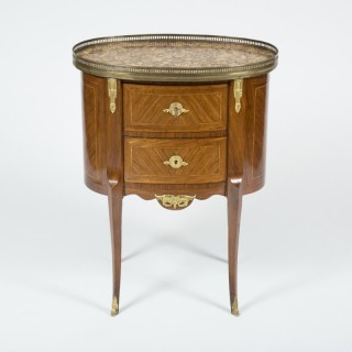oval commode in the Louis XVI style with breche d'alep top