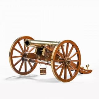 Dockyard built teak and brass field cannon