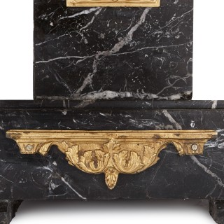 Two Art Deco black marble and gilt bronze stands