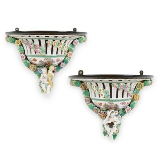 Two Meissen style decorative porcelain wall brackets