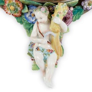 Two Meissen style decorative porcelain wall brackets