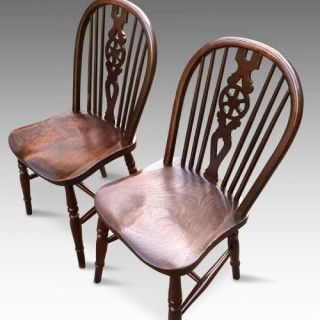 A pair of Victorian Elm and Oak Low Wheel Back Windsor side chairs