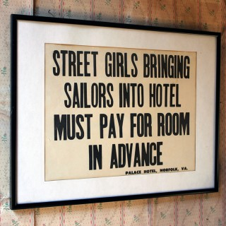 A Framed Printed Notice for The Palace Hotel, Virginia USA; Street Girls & Sailors c.1935-45