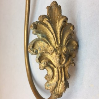 Antique gilded brass curtain tie-back
