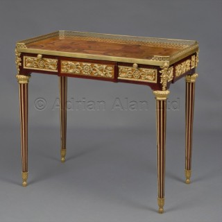 A Louis XVI Style Mahogany and Marquetry Writing Table