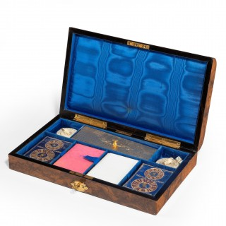 A high Victorian burr walnut games box