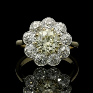 Hancocks Yellow and White Diamond Cluster Ring centred with a 1.39ct fancy Yellow Diamond