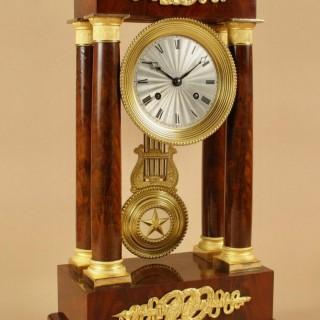 A Finely Made Louis Philippe Mahogany and Ormolu Portico Clock Circa: 1830-1837