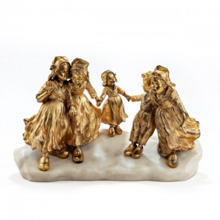 A charming gilt bronze group of Dutch children by Foste