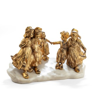 A charming gilt bronze group of Dutch children by Foste