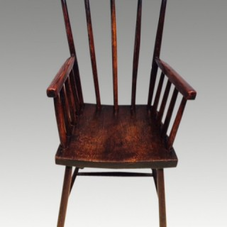 Welsh primitive stick back chair.