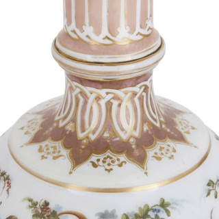 Two Bohemian opaline glass vases with painted cherub scenes