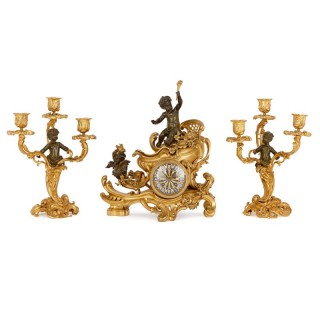 Louis XV style gilt and patinated clock set, attributed to Linke