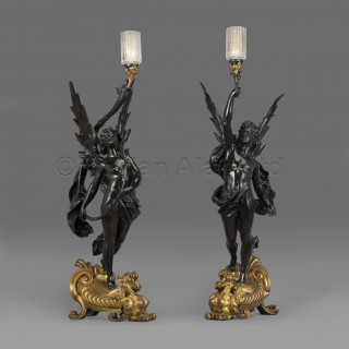 A Pair of Gilt And Patinated Bronze Figural Torcheres