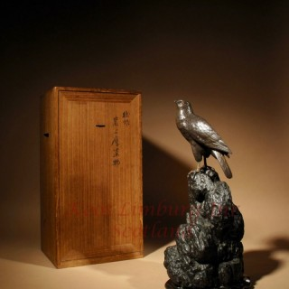 A Very Decorative Japanese Bronze Sculpture Model of a Hawk Sitting on a Craggy Rock