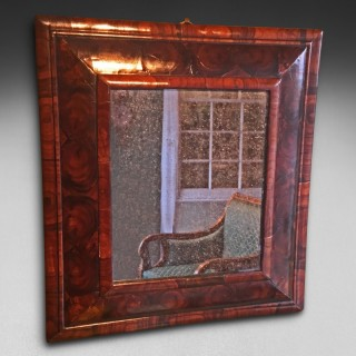Queen Anne period Oyster Veneered Walnut Cushion Framed Mirror