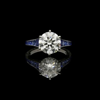 Hancocks 2.50ct old-cut Diamond and Platinum Ring with Calibre-cut Sapphire Shoulders