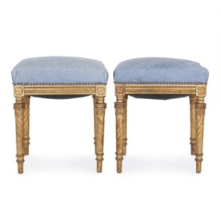 Pair of Neoclassical style upholstered giltwood stools
