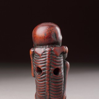 Japanese Carved Boxwood Netsuke of a Skeleton Placed in the Foetal Position
